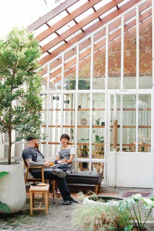 Couple of coworkers speaking in terrace