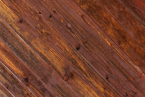 Brown Wooden Floor With White Textile
