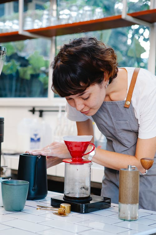 Woman preparing coffee with pour over