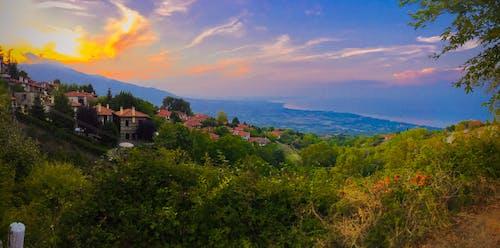 คลังภาพถ่ายฟรี ของ พระอาทิตย์ตกที่หมู่บ้าน mt olympus