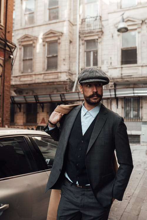 Confident man in suit on city street
