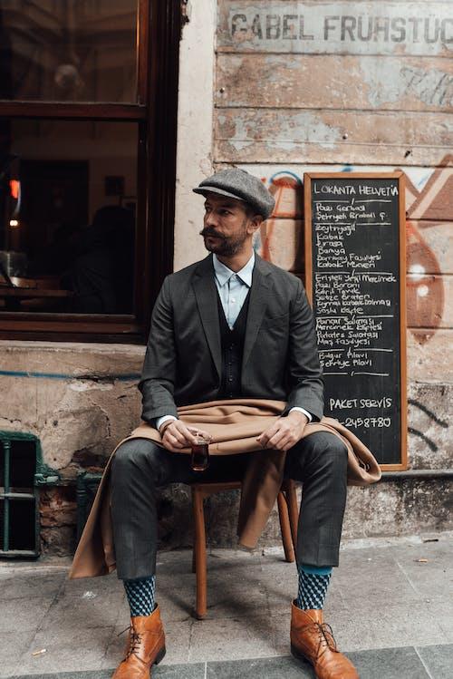 Stylish man on terrace with tea