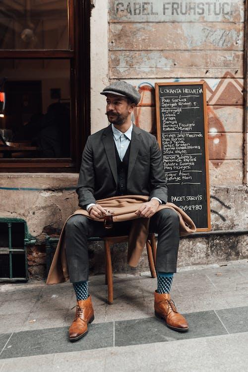 Elegant man with hot beverage on street
