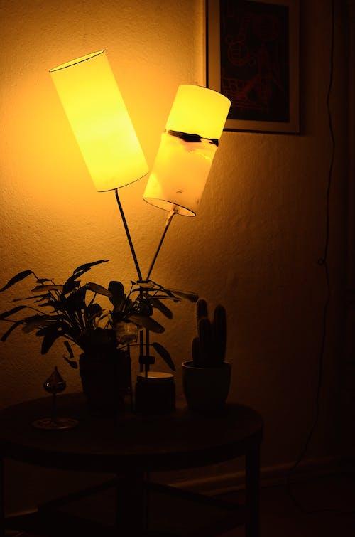 Stylish lamp illuminating dark room