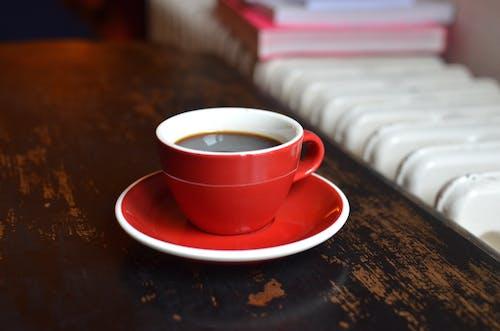 Coffee cup on table near radiator