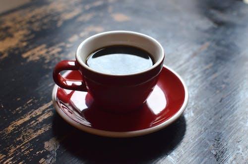 Hot fresh coffee on saucer