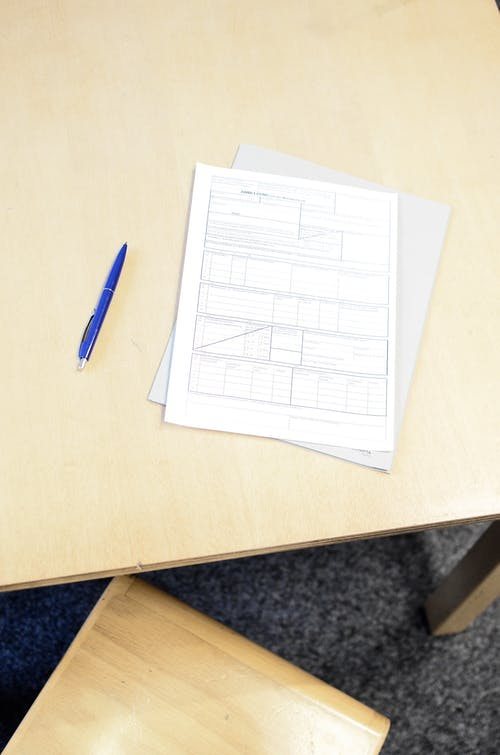 Registration form with pen on table in workspace