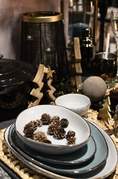 Dishware with pine cones during New Year holiday