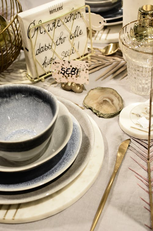Dishware with inscription on napkin during festive event