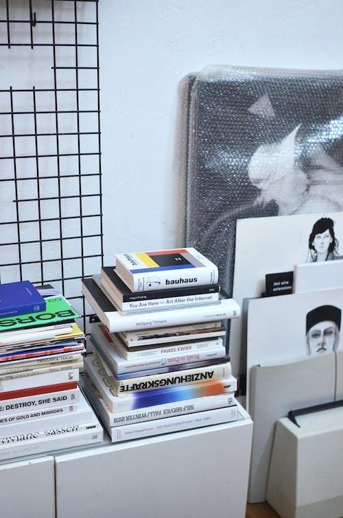 Stack of Books on White Desk