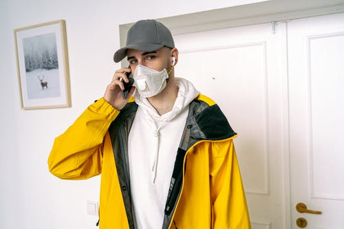Good-Looking Man in Yellow Jacket Having a Phone Call