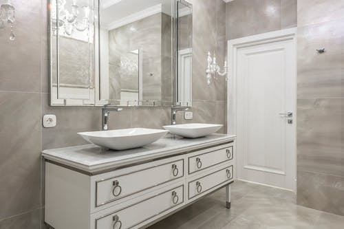 Spacious bathroom with tiled walls and floor