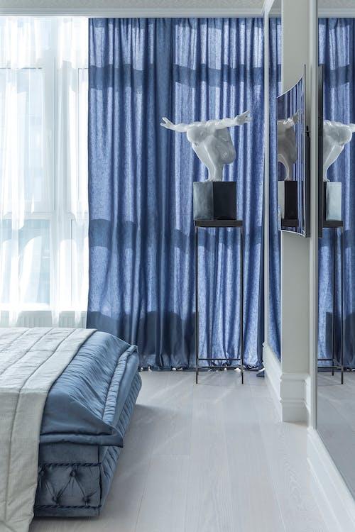 Bedroom interior with statuette in corner