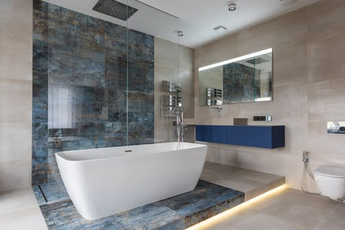 Modern bathroom interior with freestanding tub