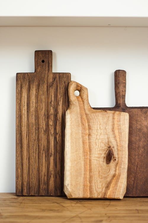 Wooden cutting boards on kitchen table