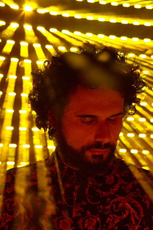 A Man Backlit by the Yellow Lights
