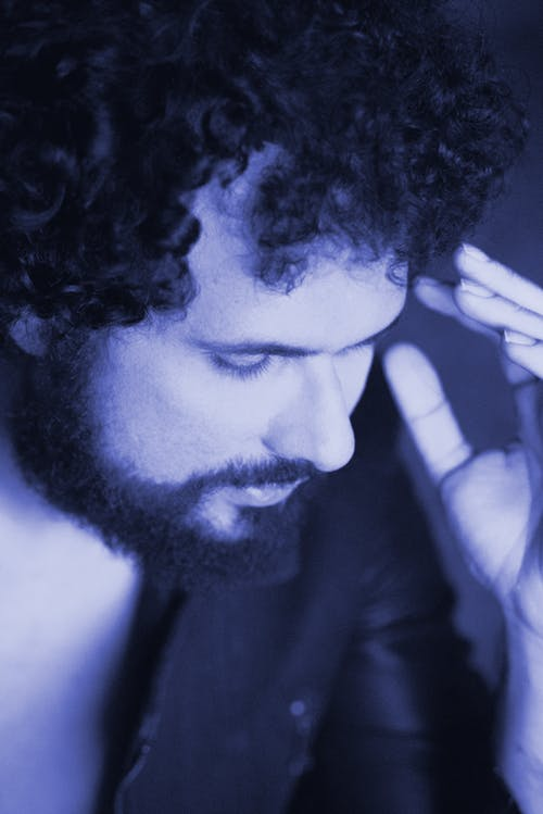 A Man Lit by Purple Lights