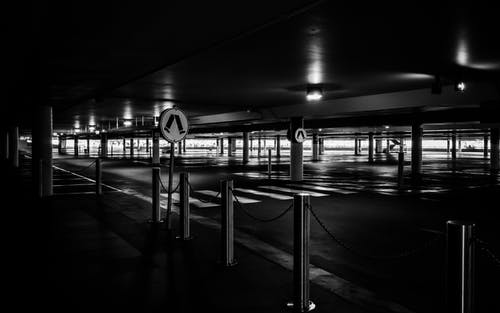 Grayscale Photo of Parking Lot