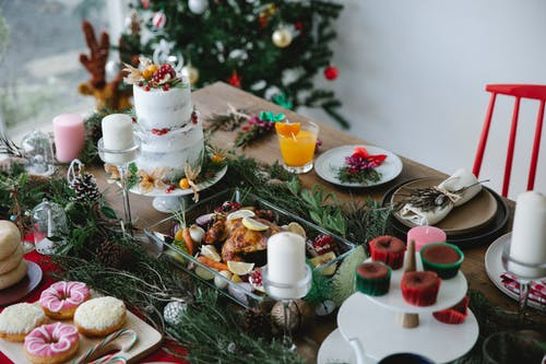 Served table for Christmas dinner decorated with coniferous twigs
