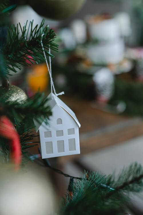 White Wooden House Ornament on Green Christmas Tree