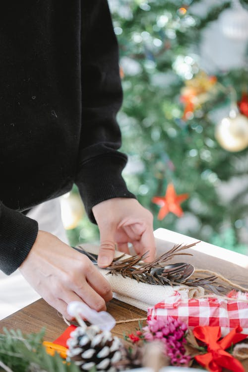 Crop man with dried twig at table