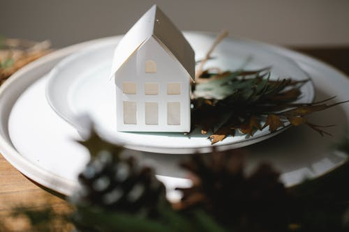 Handmade Christmas decoration on white plates