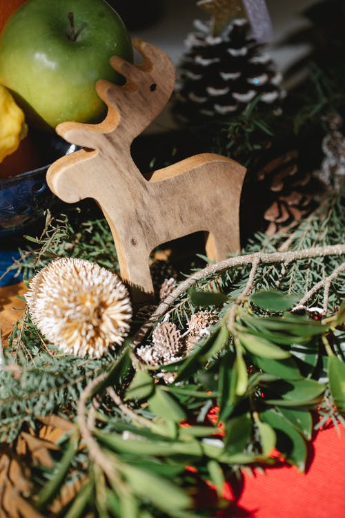 Wooden deer and green branches