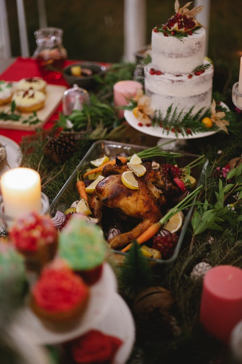 Appetizing food and desserts on table at home