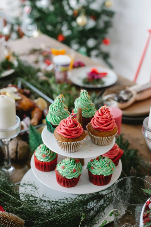 Delicious cupcakes with cream for Christmas