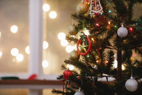 Christmas tree decorated with baubles and garland