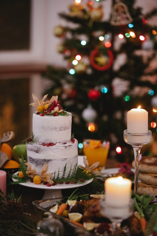 Burning candles near two tier cake