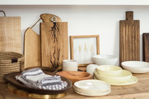 Set of ceramic dishware and cutting boards