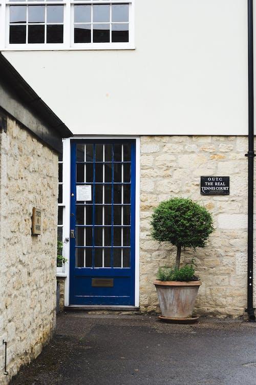 Stone building with blue door in quiet district
