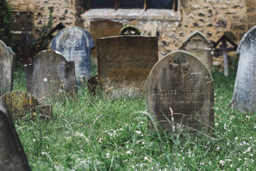 Old Christian cemetery with shabby tombstones