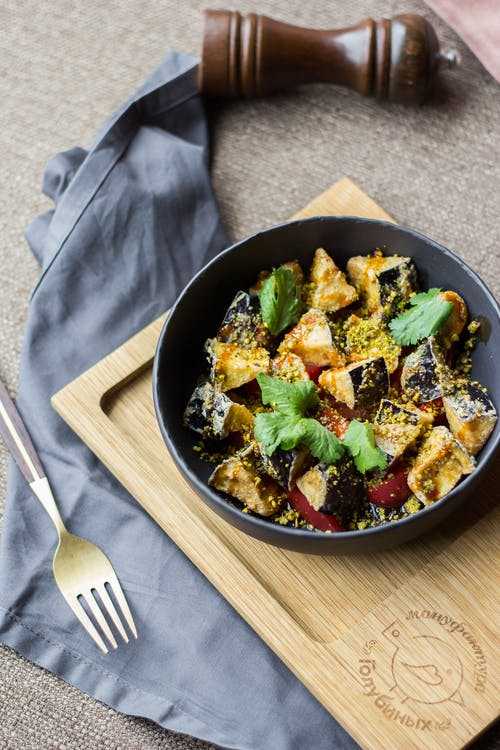 Vegetable Dish on Black Bowl Beside Silver Fork