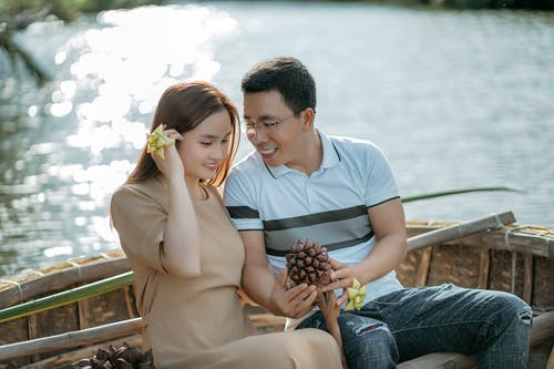 Ethnic couple on boat during romantic trip