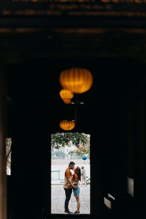 Romantic couple kissing in doorway