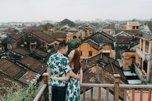 Romantic couple on terrace of rooftop in gloomy day