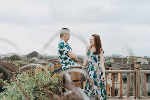 Happy couple in same outfits on roof
