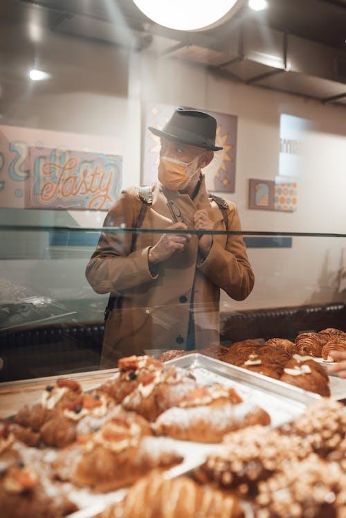 Man in medical mask in bakery