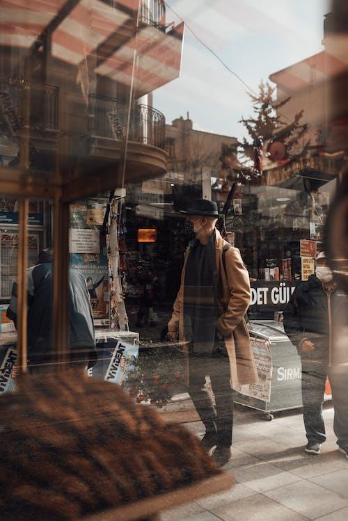 Man in mask walking in local market