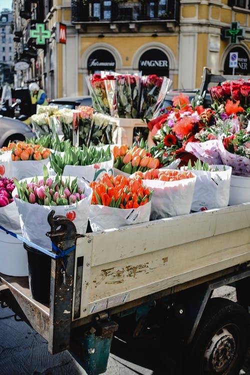 Assorted Flowers on the Back of a Truck