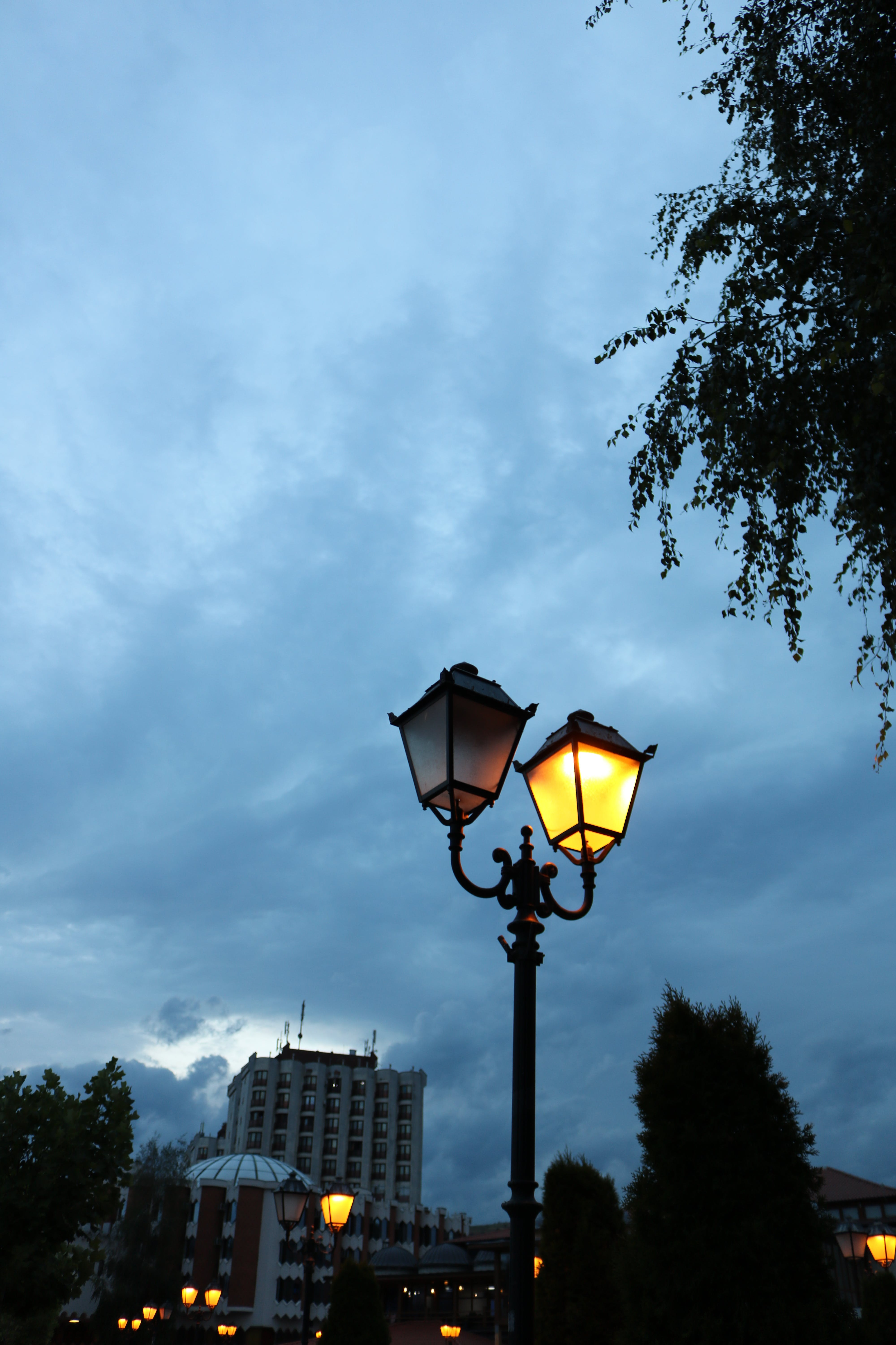 Free stock photo of city, cloudy skies, evening, lamp