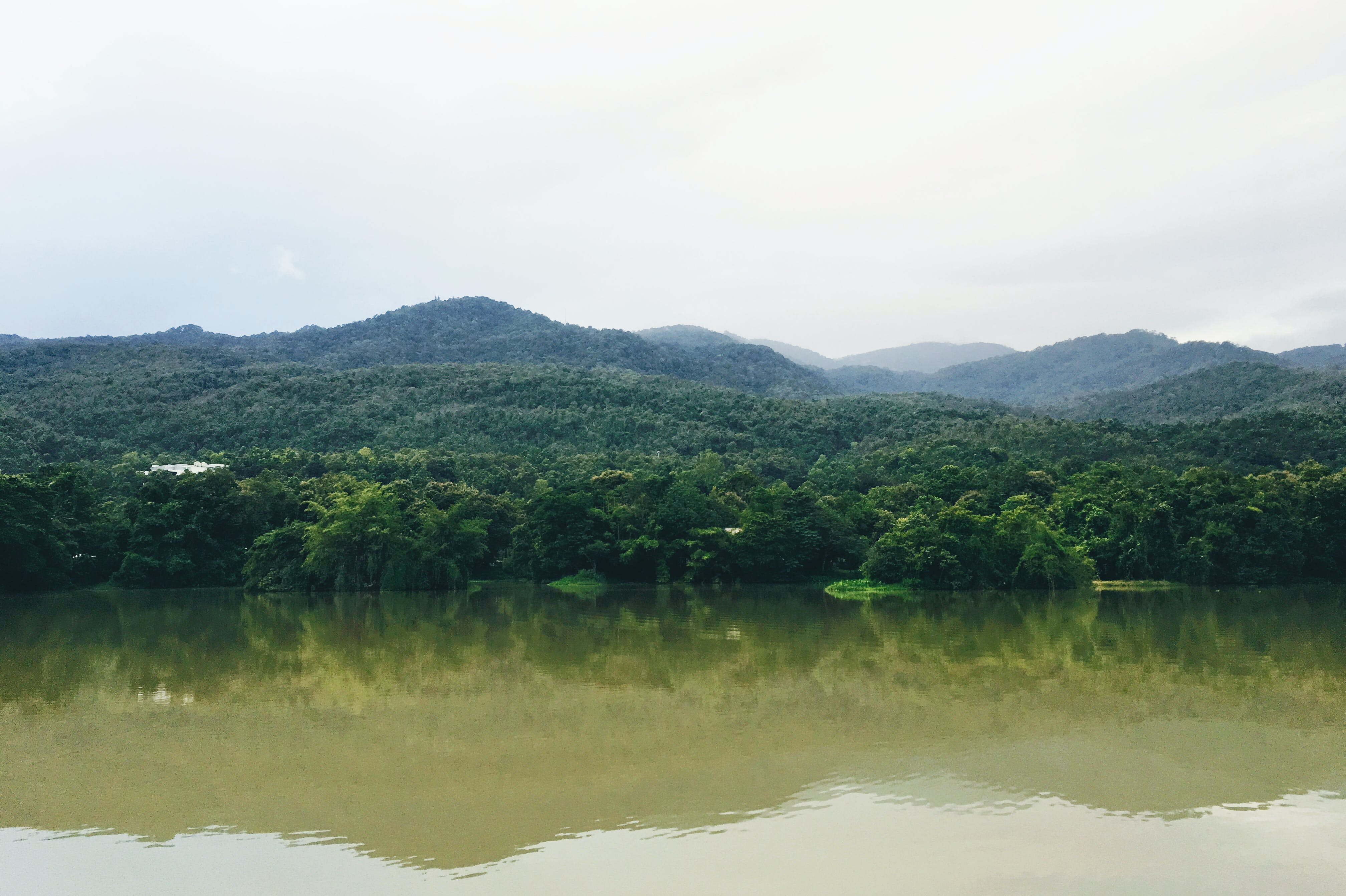 Mountain Range Near Body of Water