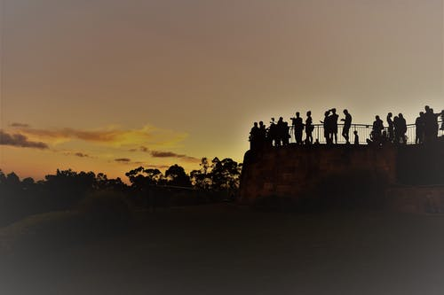Silhouette of People Standing at Terrace