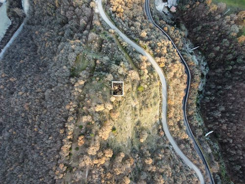 Aerial view of curvy road running through hilly terrain