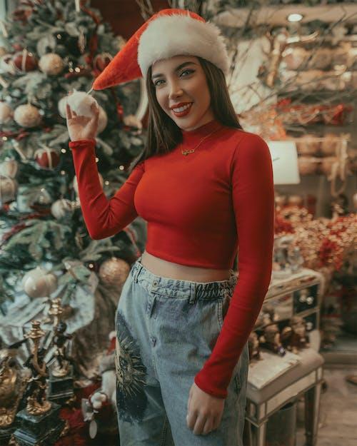 Cheerful woman standing in souvenir shop