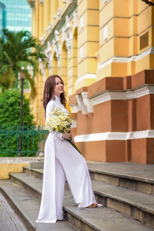 Free stock photo of ao dai, bưu điện sài gòn, nhà thờ đức bà