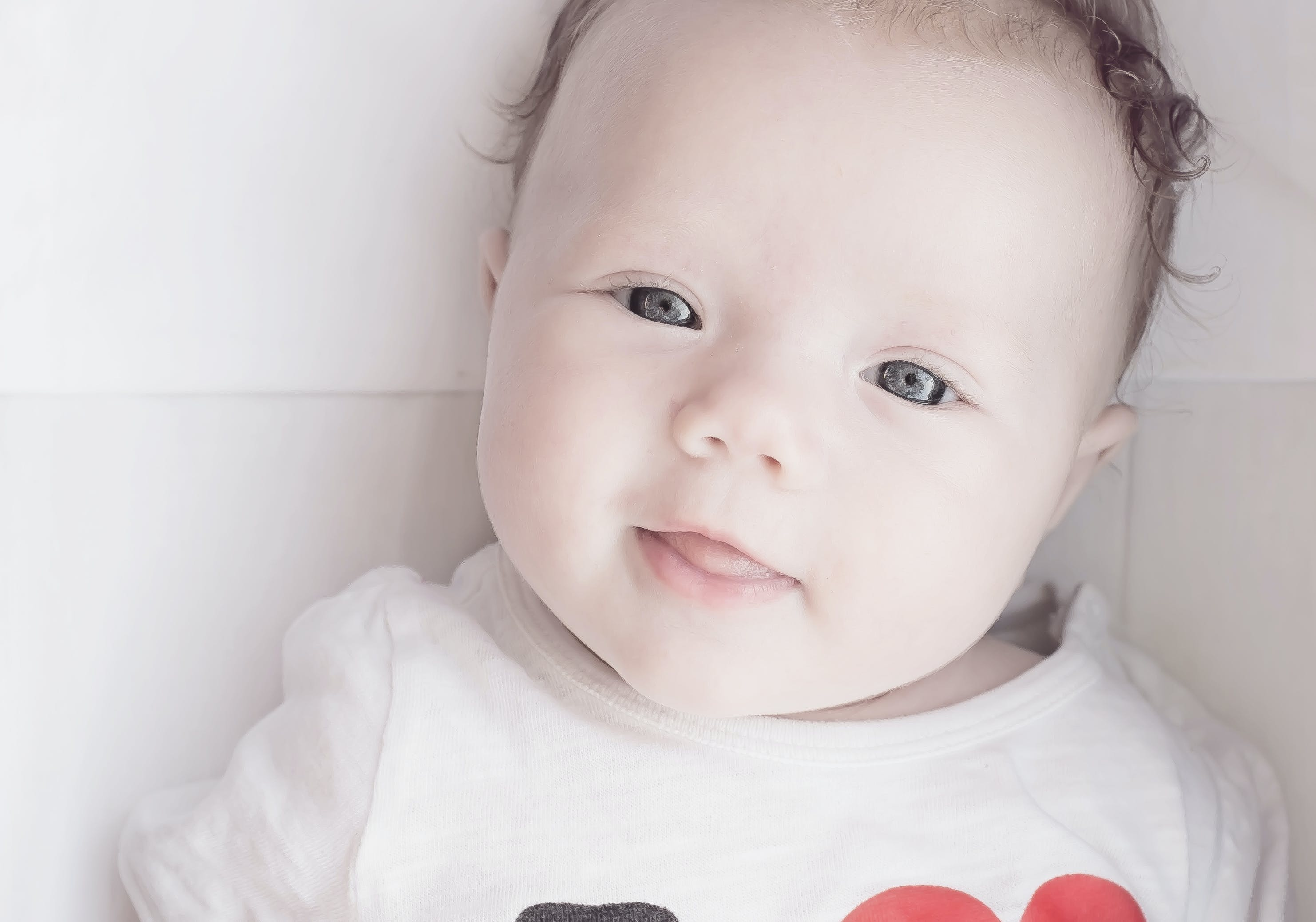 Baby Wearing White Red and Black T Shirt
