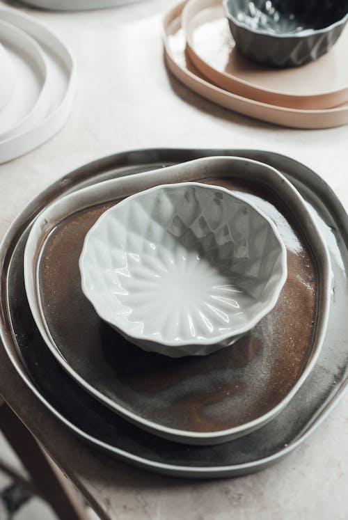 Different ceramic utensil on table in studio